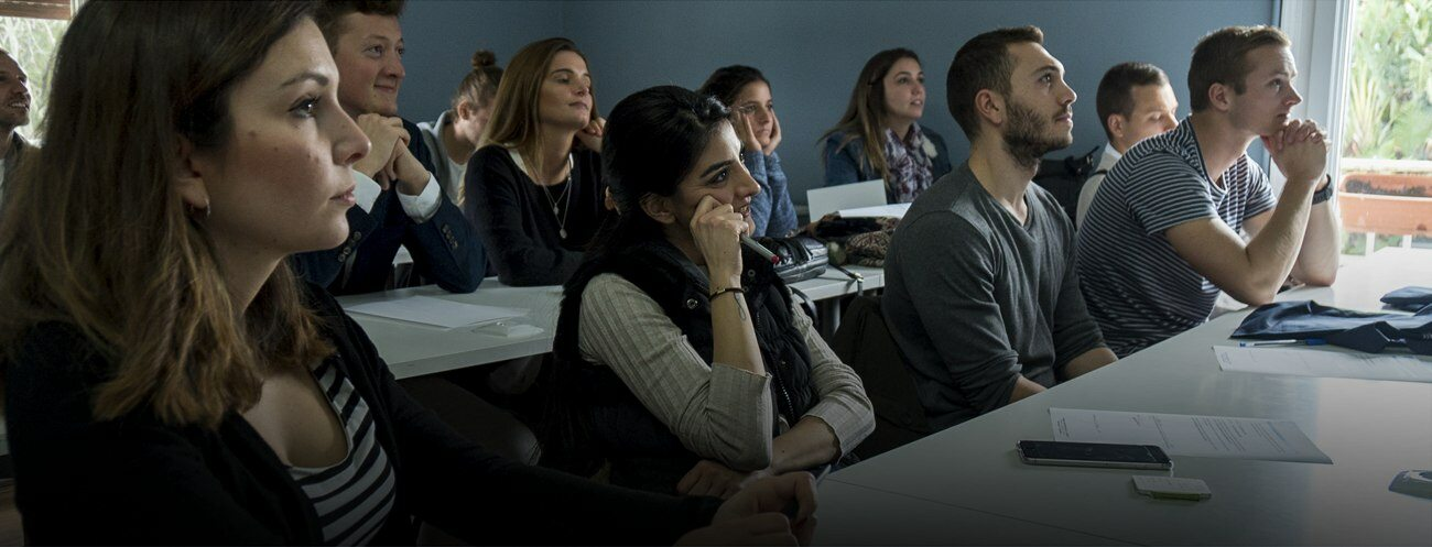 Masters students listening to their profesor